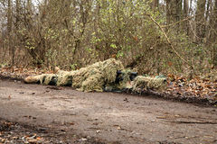 Soldier in camouflage, lies ready for the shot Royalty Free Stock Photo