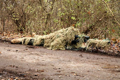 Soldier in camouflage, lies ready for the shot Royalty Free Stock Photography