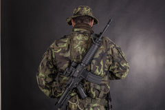 Soldier in camouflage and modern weapon M4. Stock Photo
