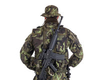 Soldier in camouflage and modern weapon M4. Royalty Free Stock Photography