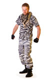 Soldier in camouflage uniform. Muscular young soldier in army clothes and camouflage paint. full-length. isolated on a white background royalty free stock photos