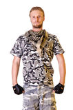 Soldier in camouflage uniform. Muscular young soldier  in army clothes and camouflage paint. isolated on a white background Royalty Free Stock Photos