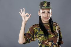Soldier in camouflage uniform looks ok sign Royalty Free Stock Photography
