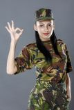 Soldier in camouflage uniform looks ok sign. Female soldier in camouflage uniform looks ok sign royalty free stock photos