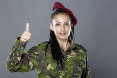 Soldier in camouflage uniform looks ok sign Royalty Free Stock Photo