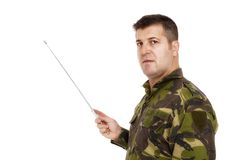 Soldier in camouflage uniform pointing Royalty Free Stock Photography