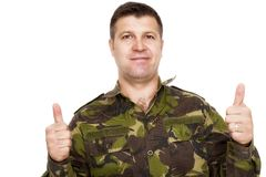 Soldier in camouflage uniform showing ok sign Stock Photos