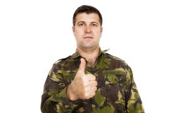 Soldier in camouflage uniform showing ok sign Royalty Free Stock Images