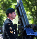 Soldier At Canada Day Celebration. Soldier beside cannon at Canada Day Celebration Edmonton Alberta 2014 Royalty Free Stock Image