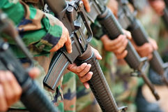 Soldier carrying gun Royalty Free Stock Photography