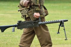 Soldier carrying machine gun Royalty Free Stock Photos