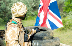 Soldier at the checkpoint. British soldier with the UK flag at the checkpoint stock photos