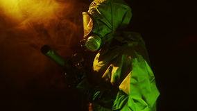 Soldier in a chemical suit standing guard with his rifle stock video footage