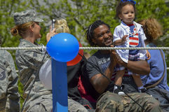 Soldier with Child in Fourth of July Parade Royalty Free Stock Photo