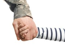 Soldier and child holding hands on white background,. Closeup Royalty Free Stock Photos