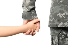 Soldier and child holding hands on white background. Closeup Royalty Free Stock Images