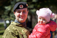 Soldier with a child. Stock Image