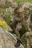Soldier climbing down the mountain Royalty Free Stock Images