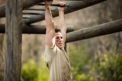 Soldier climbing monkey bars Stock Image