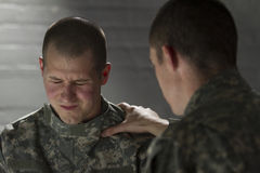 Soldier consoles peer with PTSD, horizontal Royalty Free Stock Image