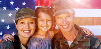 Soldier couple reunited with their daughter Stock Photography