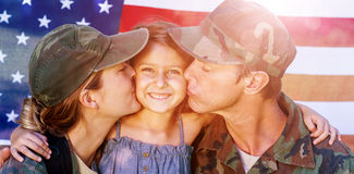 Soldier couple reunited with their daughter. In front of american flag royalty free stock photo