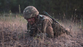 Soldier crawling in field Royalty Free Stock Photos