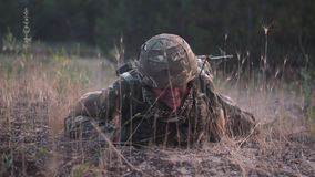 Soldier crawling in field Royalty Free Stock Photography