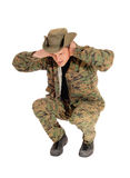 Soldier crouching on floor. Royalty Free Stock Photography