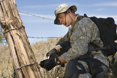 Soldier Cutting Barbed Wire Fence Royalty Free Stock Image