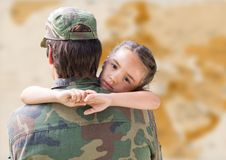 Soldier and daughter against blurry brown map stock image