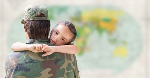 Soldier and daughter against blurry map stock photo