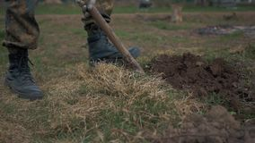 Soldiers digging earth. The soldier is digging the snake for defense stock video footage