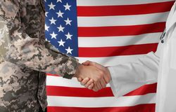 Soldier and doctor shaking hands on American Royalty Free Stock Photography