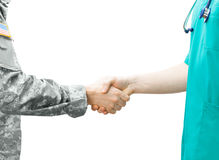 Soldier and doctor shaking hands on white background. Soldier and doctor shaking hands stock photo