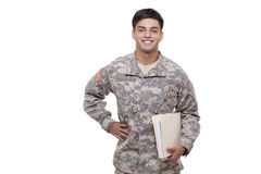 Soldier with documents against white background Royalty Free Stock Image