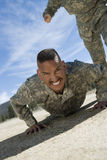 Soldier Doing Pushups. Portrait of male soldier doing pushups during training royalty free stock images