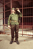 Soldier drinking from field bottle Stock Images