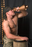 The soldier drinks from a jug royalty free stock photo