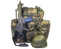 Soldier equipment: weapon, backpack, helmet Stock Photography