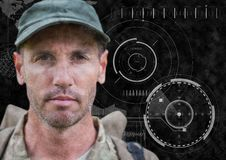 Soldier face against black background with interface and grunge overlay Stock Photos