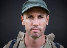 Soldier face against navy chalkboard royalty free stock photos