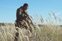 Soldier with  in the field. Soldier with a rifle in the field Stock Images