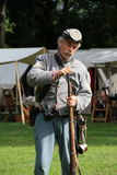 Soldier filling rifle with ammunition during Civil War re-enactment,Saratoga Springs,New York,2013 Stock Image