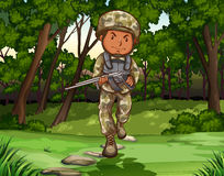 Soldier. With firegun walking in the warzone Royalty Free Stock Image
