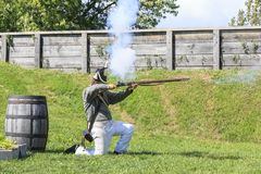 Soldier fires the musket Royalty Free Stock Photography