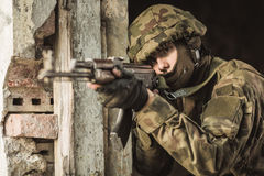 Soldier firing weapon Stock Photo