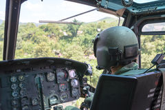 Soldier flying helicopter Stock Photos