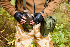 Soldier in a forest with flask Royalty Free Stock Photos
