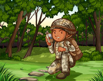 Soldier in forest on radio Stock Photo